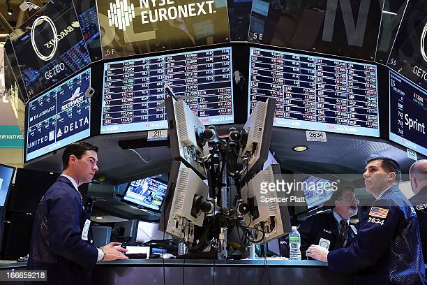 Traders work on the floor of the New York Stock Exchange on April 15 2013 in New York City Following disappointing news on economic growth in China...