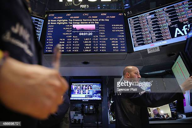 Traders work on the floor of the New York Stock Exchange on April 25 2014 in New York City With growing concerns about turmoil in Ukraine and worries...