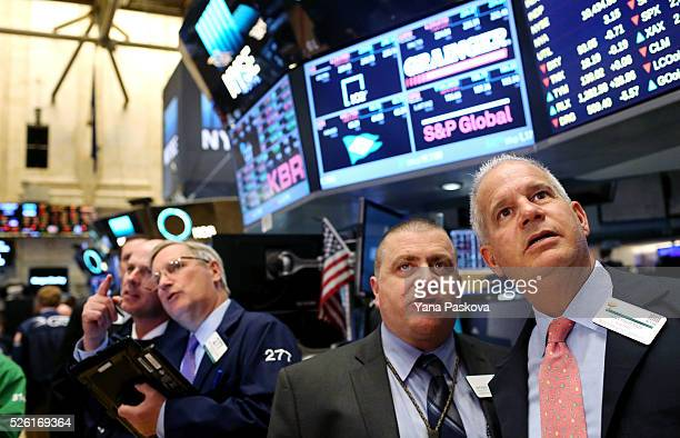 Traders work on the floor of the New York Stock Exchange on April 29 2016 in New York City The Dow Jones Industrial Average closed down over 100...