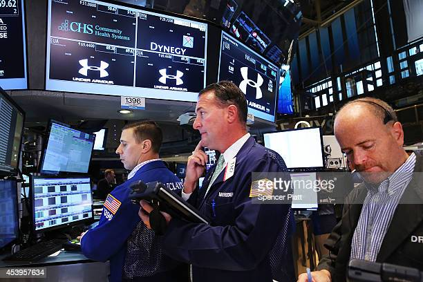 Traders work on the floor of the New York Stock Exchange on August 22 2014 in New York City In morning trading the Dow fell 25 points as markets...