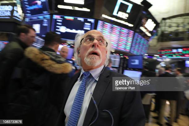 Traders work on the floor of the New York Stock Exchange on December 17 2018 in New York City Stocks fell again in morning trading as investors...