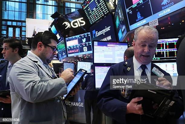 Traders work on the floor of the New York Stock Exchange on December 19 2016 in New York City Markets rose modestly in morning trading as the Dow...
