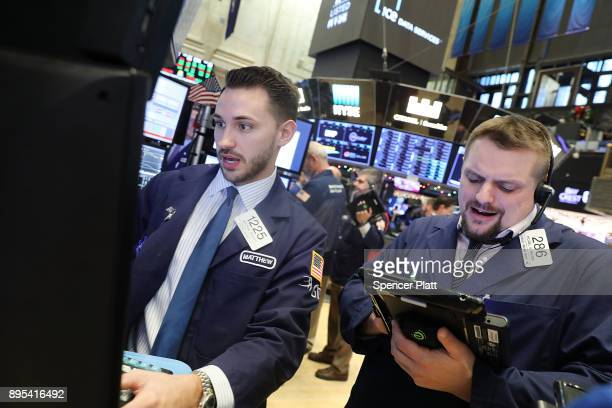 Traders work on the floor of the New York Stock Exchange on December 19 2017 in New York City The Dow Jones industrial average rose in morning...
