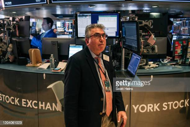 Traders work on the floor of the New york Stock Exchange on February 28 2020 in New York City Markets continued their downward plunge Friday as...