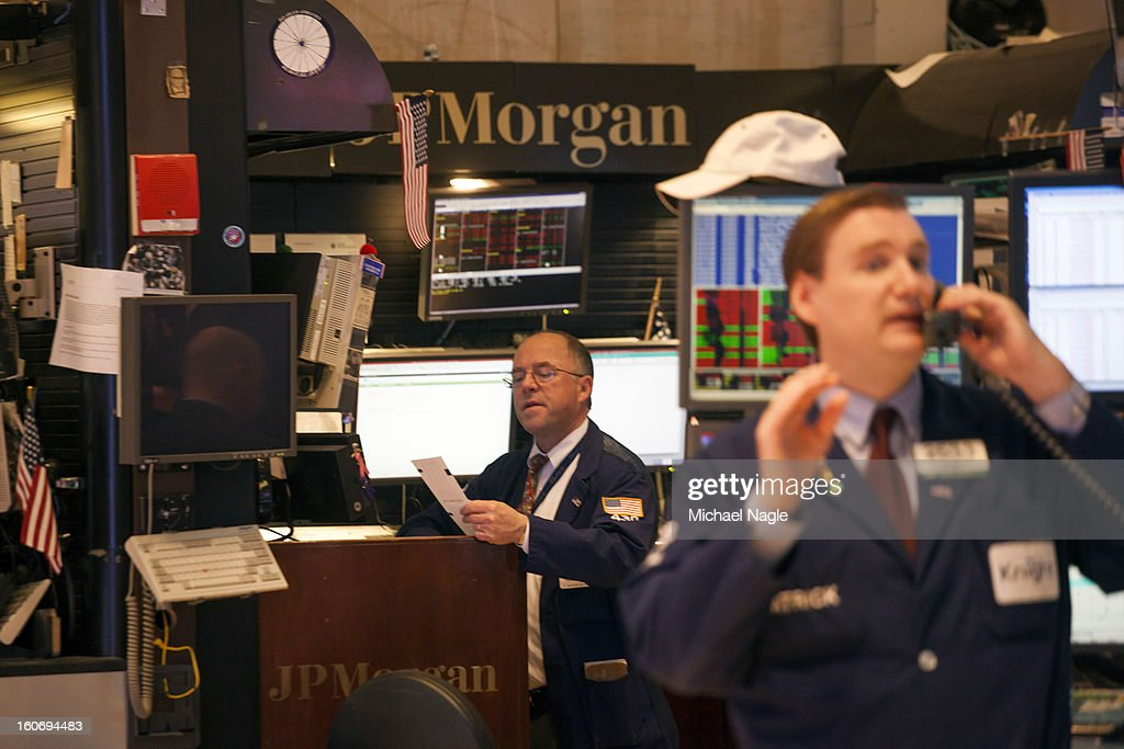 Traders work on the floor of the New York Stock Exchange on February 4, 2013 in New York City. Stocks dropped sharply today following the Dow's close last week above 14000.