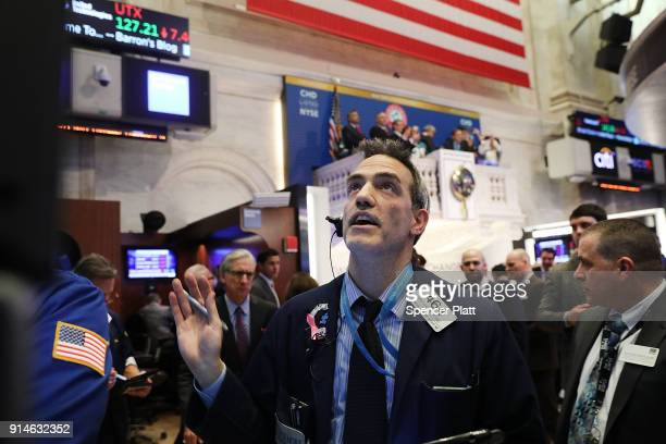Traders work on the floor of the New York Stock Exchange on February 5 2018 in New York City Following Fridays's over 600 point drop the Dow Jones...