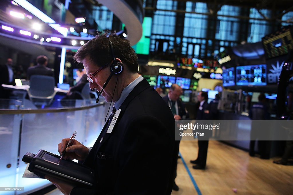 Traders work on the floor of the New York Stock Exchange on January 9, 2013 in New York City. Following strong fourth-quarter results from Aluminum producer Alcoa, the Dow Jones Industrial Average gained 0.6% in morning trading with the the S&P 500 and the NASDAQ both rising more than 0.4%.