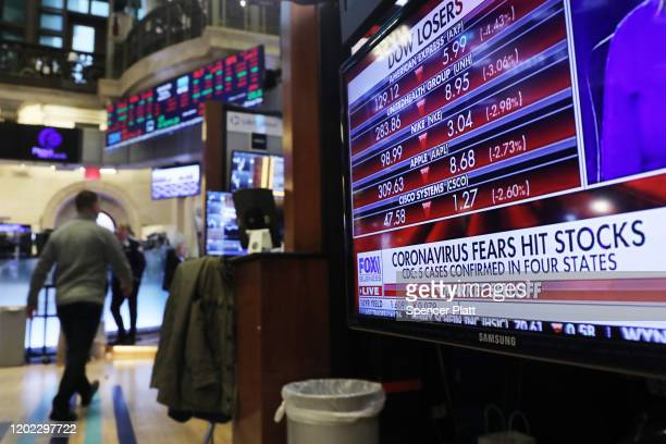 Traders work on the floor of the New York Stock Exchange on January 27 2020 in New York City US stocks fell sharply in morning trading as fears over...