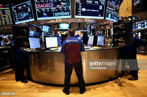 Traders work on the floor of the New York Stock Exchange on January 05 2015 in New York City US stocks fell over 330 points due to a plunge in energy...