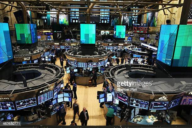 Traders work on the floor of the New York Stock Exchange on January 14 2014 in New York City Following a drop in the market on Monday stocks were up...