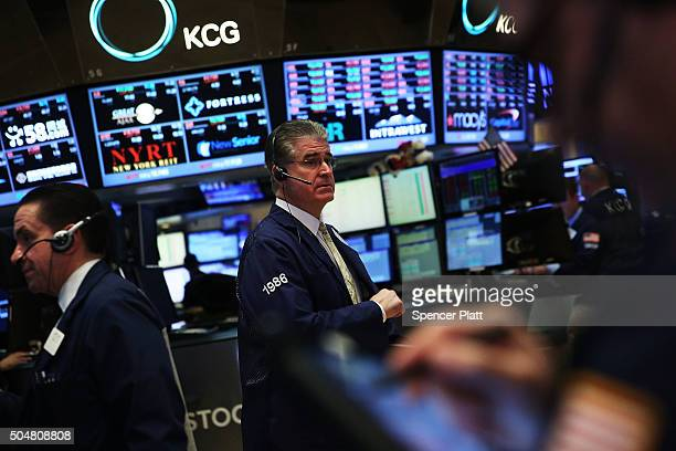 Traders work on the floor of the New York Stock Exchange on January 13 2016 in New York City The Dow Jones industrial average fell over 350 points...