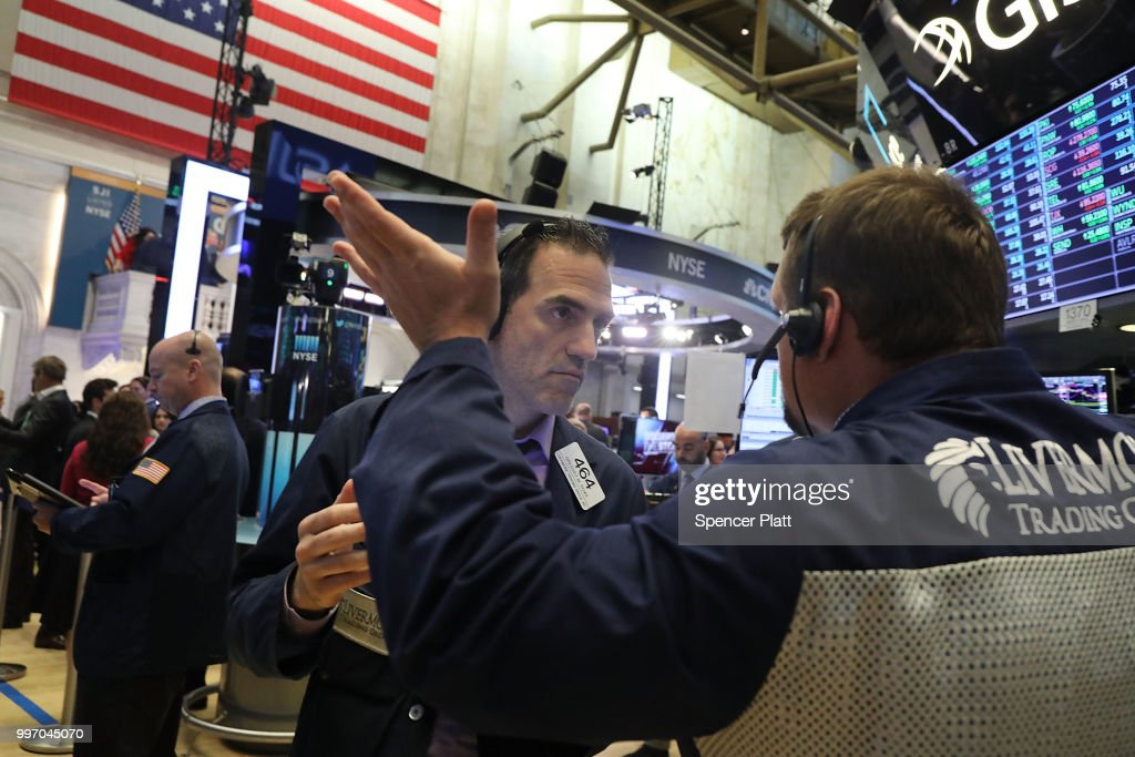 Traders work on the floor of the New York Stock Exchange (NYSE) on July 12, 2018 in New York City. As fears of a trade war eased with China, the Dow Jones Industrial Average rose 140 points in morning trading.