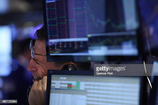 Traders work on the floor of the New York Stock Exchange on July 27 2015 in New York City The Dow Jones industrial average was down 150 points in...