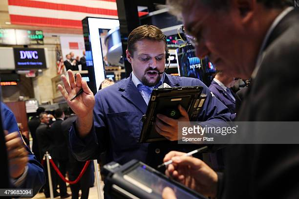 Traders work on the floor of the New York Stock Exchange on July 6 2015 in New York City Following news that Greece has voted 'No' in a referendum on...