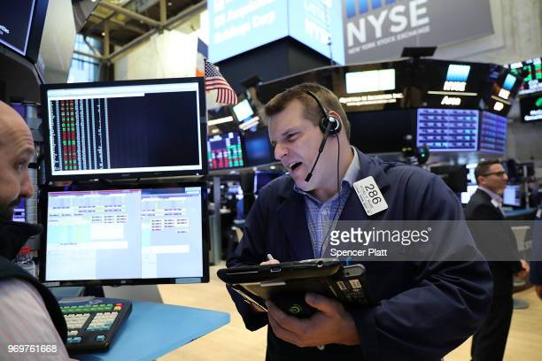 Traders work on the floor of the New York Stock Exchange on June 8 2018 in New York City Stocks were lower in morning trading as investors watch...