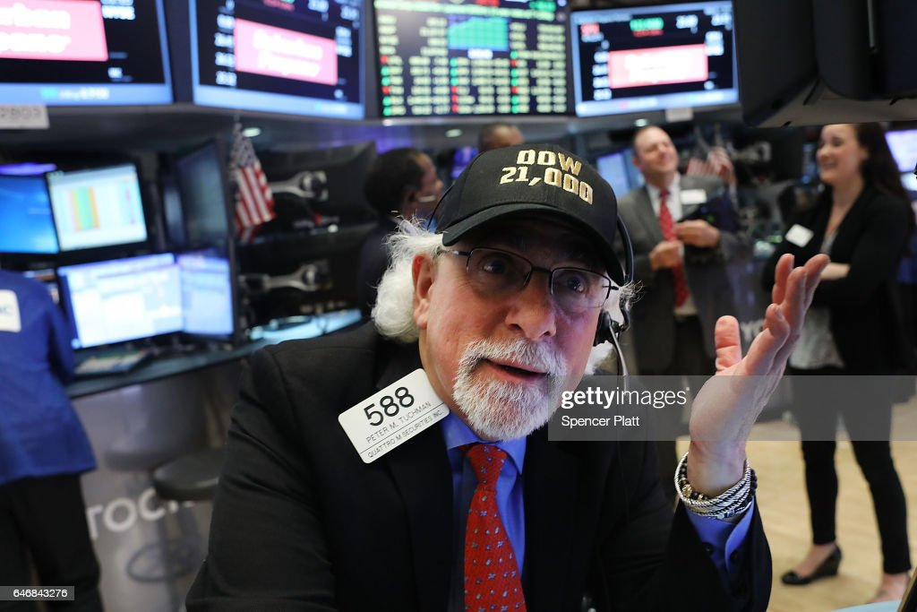 Traders work on the floor of the New York Stock Exchange (NYSE) on March 1, 2017 in New York City. Stocks surged on Wednesday sending the Dow Jones industrial average over 21,000 points.
