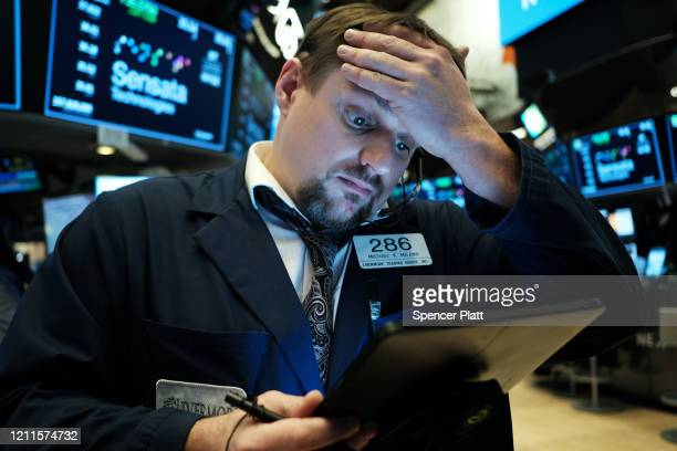Traders work on the floor of the New York Stock Exchange on March 10, 2020 in New York City. After losing nearly 8 percent in a market rout...