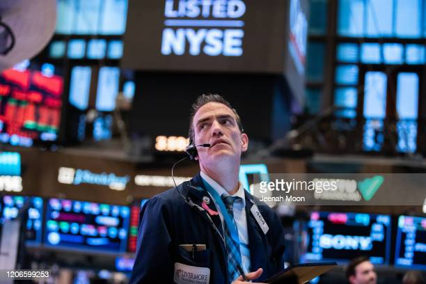Traders work on the floor of the New York Stock Exchange on March 11, 2020 in New York City. The Dow plunged more than 1400 points as Coronavirus...
