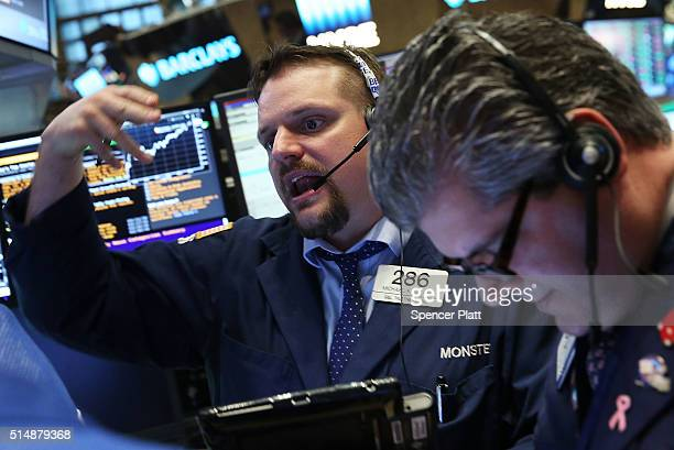 Traders work on the floor of the New York Stock Exchange on March 11 2016 in New York City Following news of a European Central Bank stimulus and a...