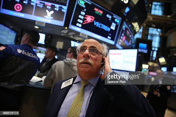 Traders work on the floor of the New York Stock Exchange on March 16 2015 in New York City The Dow Jones industrial average finished up 228 points...
