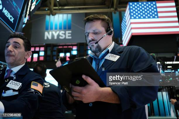 Traders work on the floor of the New York Stock Exchange on March 17, 2020 in New York City. The Dow was up slightly in morning trading following a...
