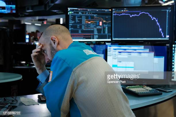 Traders work on the floor of the New York Stock Exchange on March 18, 2020 in New York City. The Dow fell more than 1,200 points today as COVID-19...
