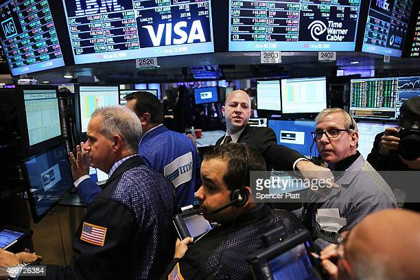 Traders work on the floor of the New York Stock Exchange on March 18 2015 in New York City Following news that the Federal Reserve will not raise...