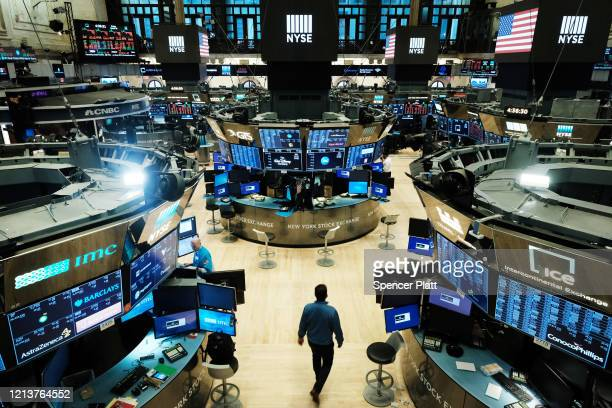 Traders work on the floor of the New York Stock Exchange on March 20, 2020 in New York City. Trading on the floor will temporarily become fully...