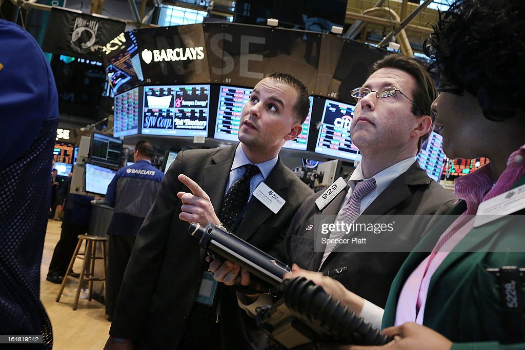 Traders work on the floor of the New York Stock Exchange on March 28, 2013 in New York City. The S&P 500 finished at an all time high, gaining 6 points, or 0.4%, to end at a record close of 1569.19.