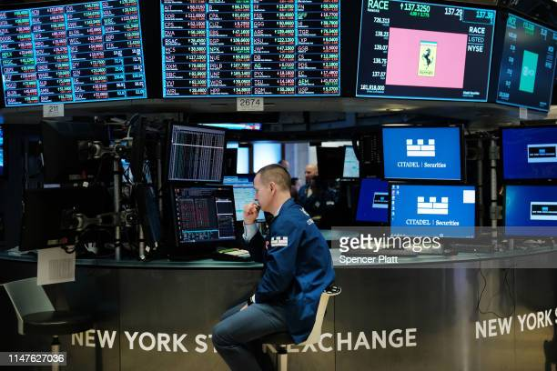Traders work on the floor of the New York Stock Exchange on May 07, 2019 in New York City. The Dow fell over 450 points today as investors continue...