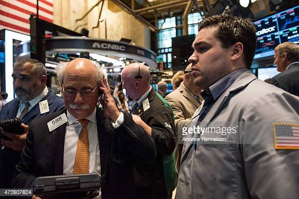 Traders work on the floor of the New York Stock Exchange on May 8 2015 in New York City Positive Jobs Reports sent the Dow Jones Industrial Average...