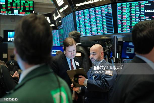 Traders work on the floor of the New York Stock Exchange on November 04 2019 in New York City US stocks finished at records highs on Monday with the...