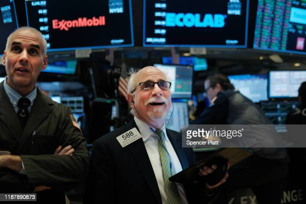 Traders work on the floor of the New York Stock Exchange on November 15, 2019 in New York City. As trade talks with China show some progress, the Dow...