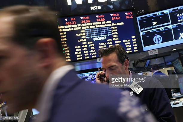Traders work on the floor of the New York Stock Exchange on November 15 2012 in New York City Stocks were trading slightly lower in morning trading...