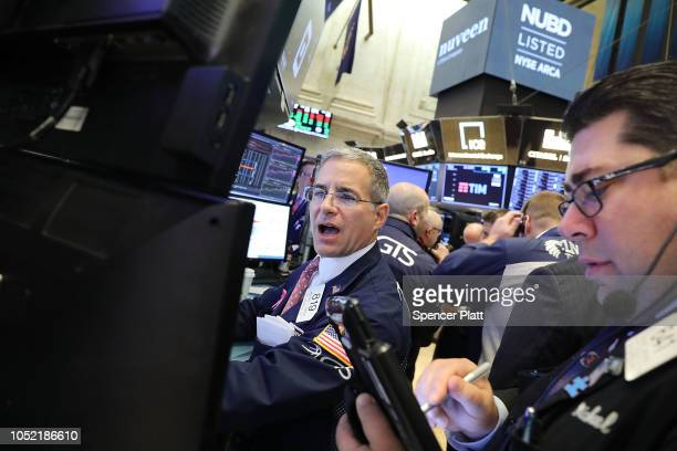 Traders work on the floor of the New York Stock Exchange on October 15 2018 in New York City Following a week of steep losses and modest gains the...