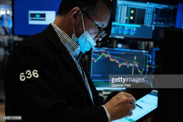 Traders work on the floor of the New York Stock Exchange on October 15, 2021 in New York City. The Dow Jones Industrial Average opened 250 points...