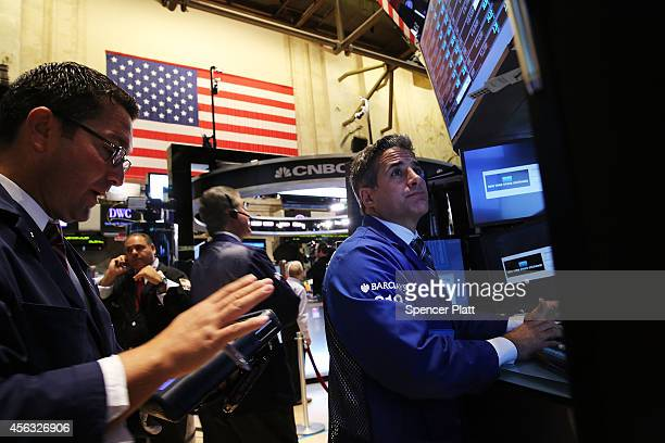 Traders work on the floor of the New York Stock Exchange on September 29 2014 in New York City In morning trading the Dow opened down more than 100...