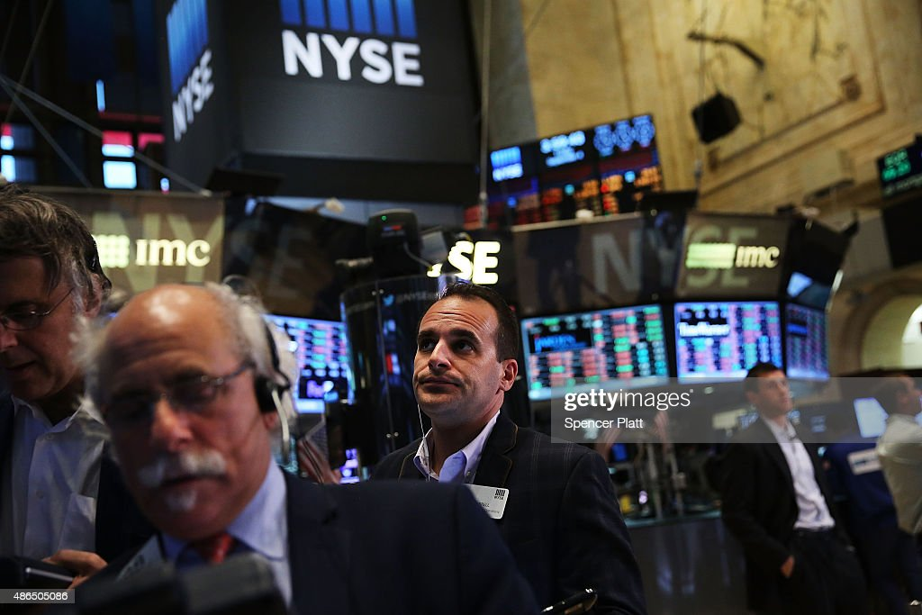 Traders work on the floor of the New York Stock Exchange (NYSE) on September 4, 2015 in New York City. The Dow Jones industrial average finished the day down over 250 points, furthering losses for the week.