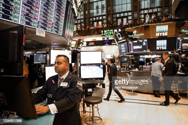 Traders work on the floor of the New York Stock Exchange on the evening of November 7 2018 in New York City Stocks rose over 500 points the day after...