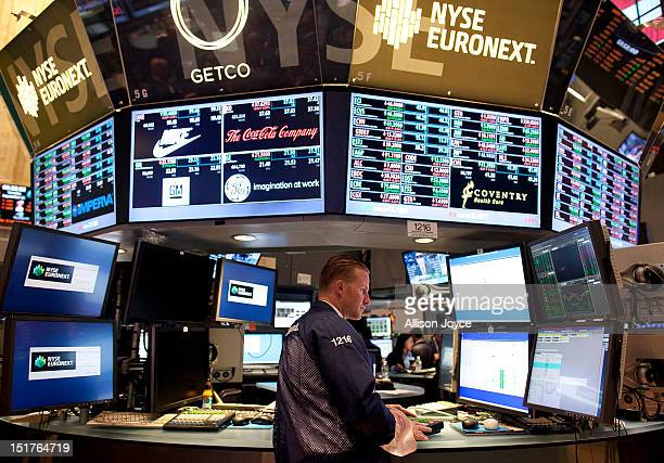 Traders work on the floor of the New York Stock Exchange on the eleventh anniversary of the 9/11 terrorist attacks on September 11 2012 in New York...