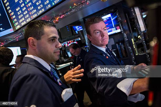Traders work on the floor of the New York Stock Exchange on the morning of December 22 2014 in New York City Stocks continue to rise to record highs...