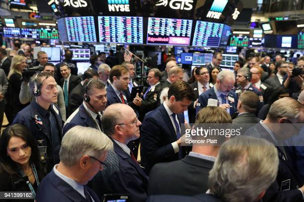 Traders work on the floor of the New York Stock Exchange on the morning that the music streaming service Spotify begins trading shares at the NYSE on...