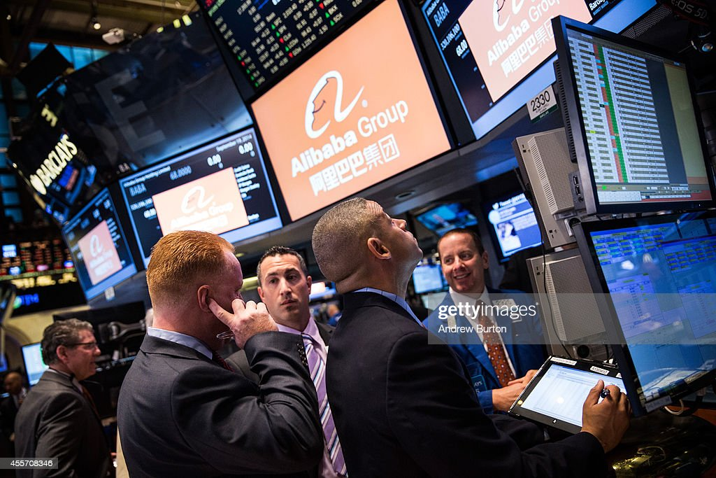 Traders work on the floor of the New York Stock Exchange prior to Alibaba Group's initial price offering (IPO) on September 19, 2014 in New York City. The New York Times reported yesterday that Alibaba had raised $21.8 Billion in their initial public offering so far.