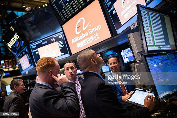 Traders work on the floor of the New York Stock Exchange prior to Alibaba Group's initial price offering on September 19, 2014 in New York City. The...