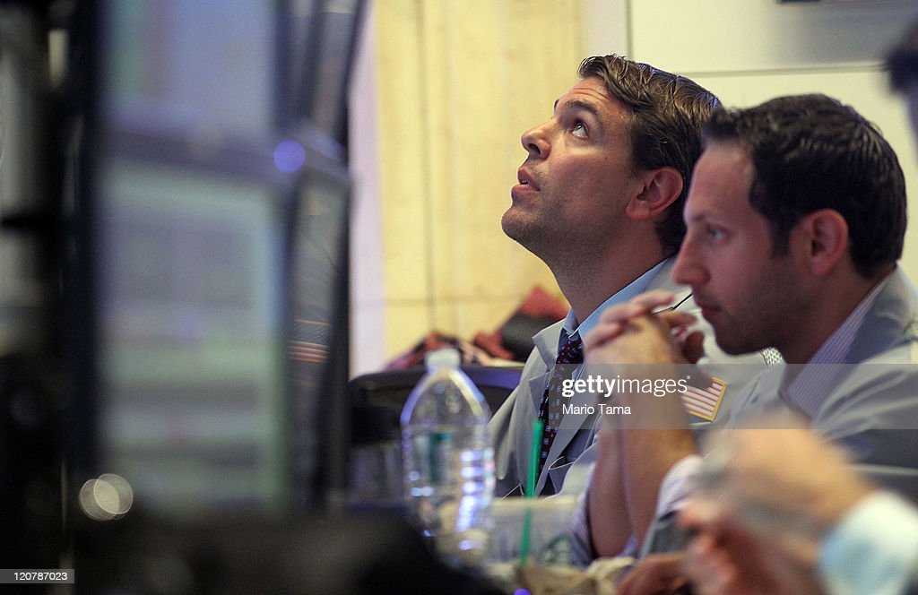 Traders work on the floor of the New York Stock Exchange prior to the closing bell on August 10, 2011 in New York City. The Dow plummeted more than 500 points at the end of the day as global economic turmoil continues.