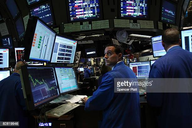Traders work on the floor of the New York Stock Exchange September 15 2008 in New York City In morning trading US stocks suffered a steep loss after...