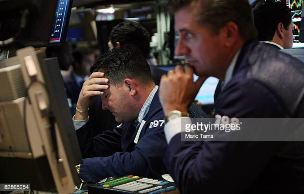 Traders work on the floor of the New York Stock Exchange September 17, 2008 in New York City. The Dow Jones Industrial Average closed down 449 points...