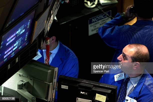 Traders work on the floor of the New York Stock Exchange September 29 2008 in New York City US stocks took a nosedive in reaction to the global...