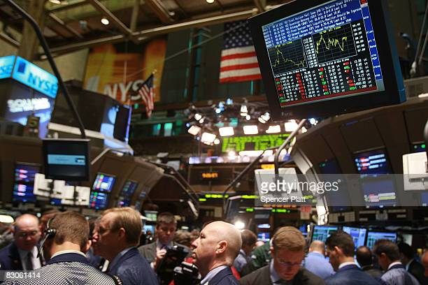 Traders work on the floor of the New York Stock Exchange September 30 2008 in New York City Yesterday the Dow fell over 777 points or nearly 7...