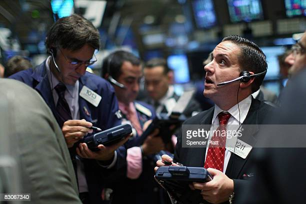 Traders work on the floor of the New York Stock Exchange September 30 2008 in New York City The Dow rose 48521 points after losing 777 points in...